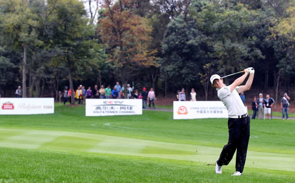 Rory McIlroy guarding the Sponsor boards at the World Golf Championship