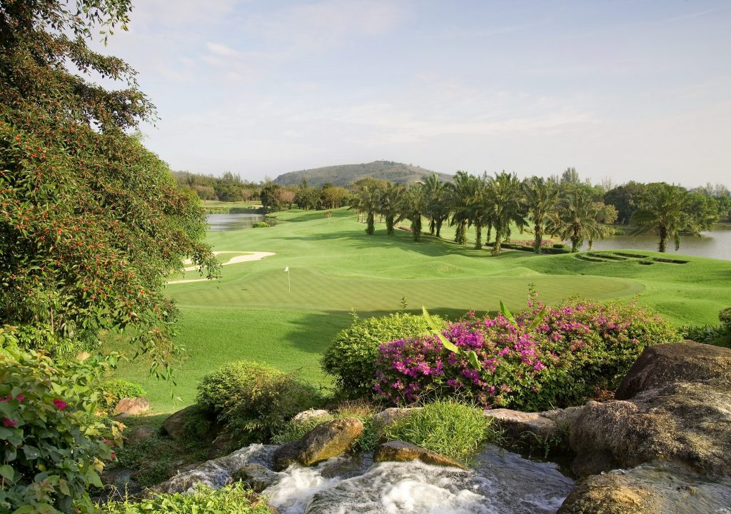 blue canyon country club phuket thailand 18th green and waterfall