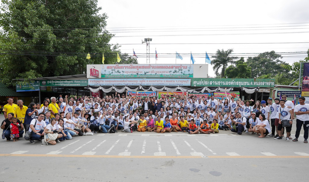 Asian people in a large group shot at an event in Thailand.