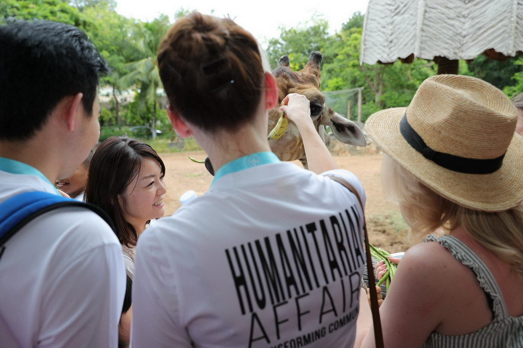 participants at a United Nations event in Thailand planting rice.