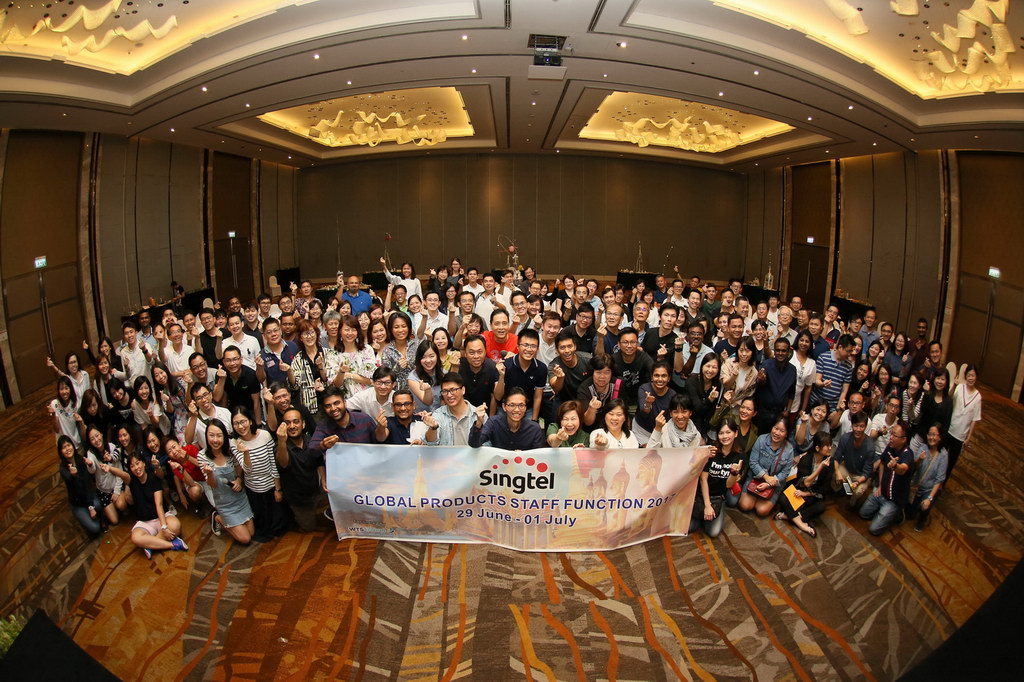 group photo of people at a bangkok meeting in the convention centre.