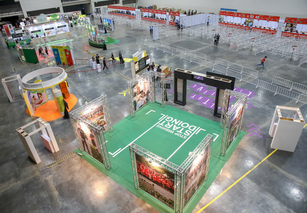 Convention floor with booths at a bangkok event.